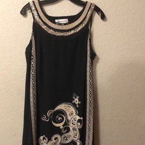 A line dress with embellishments. Super chic